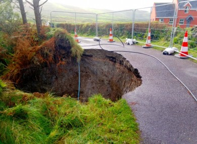 The sinkhole which has developed on a road in Co Cork