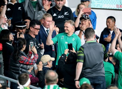 Joe Schmidt walks down through the crowd after the game.