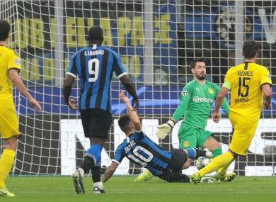 Lautaro Martinez scores past Roman Burki