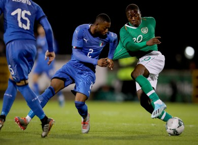 Ireland's Michael Obafemi with Claud Adjapong of Italy.
