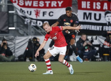 AZ player Dani de Wit and Manchester United's Marcus Rashford compete for the ball.