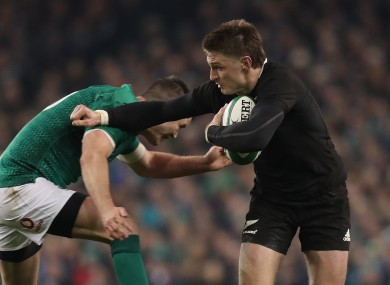 Beauden Barrett fends off the tackle of Johnny Sexton in 2016.