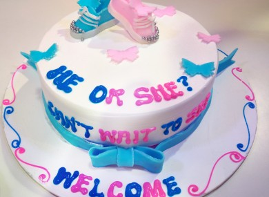 People gather at a gender reveal party to find out the gender of an unborn baby.