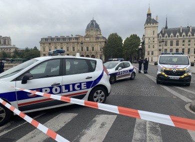 Police at the scene of yesterday's stabbing in Paris.