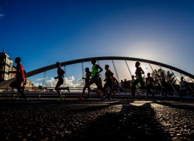 Runners cross the James Joyce bridge during the 2018 marathon.