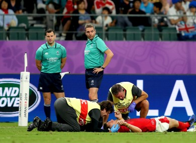 Dan Biggar receives medical attention following a clash with a fellow Welshman.