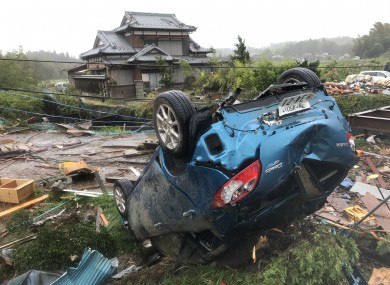 A car is overturned after a tornado hit Chiba Prefecture near Tokyo.