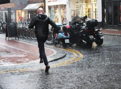 A man runs for shelter in Dublin city centre.