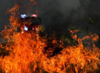 Firefighters battle flames during bushfires near Taree, New South Wales