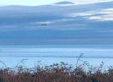 A helicopter and lifeboats are searching for the missing aircraft and its pilot.