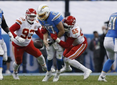 Chargers quarterback Philip Rivers, center, is sacked by Kansas City Chiefs defensive end Frank Clark and defensive tackle Joey Ivie.
