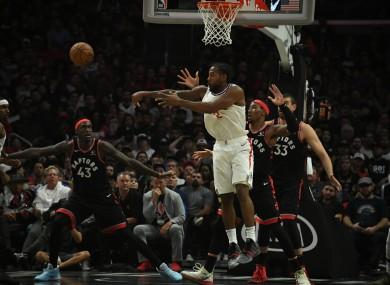 LA Clippers forward Kawhi Leonard passes the ball.