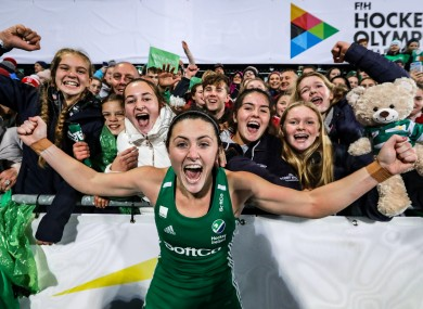 Roisin Upton celebrates with fans after Sunday's game.