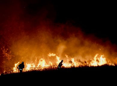 Firefighters tackle bushfires in Australia.