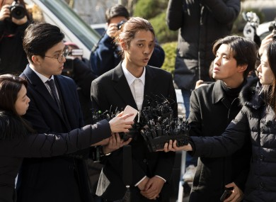 Jung Joon-young outside a police station in Seoul earlier this year