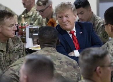 Trump speaking with US soldiers during his visit.
