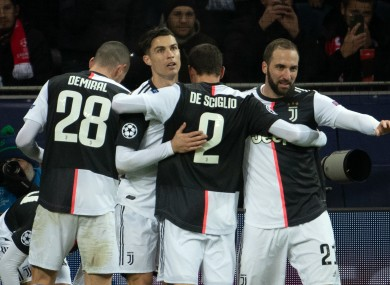 Ronaldo (centre) is embraced by team-mates.