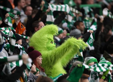 Grinch celebrates Celtic's win, not Christmas.