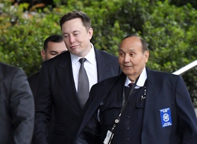 Tesla CEO Elon Musk, second from right, arrives at the US District Court.