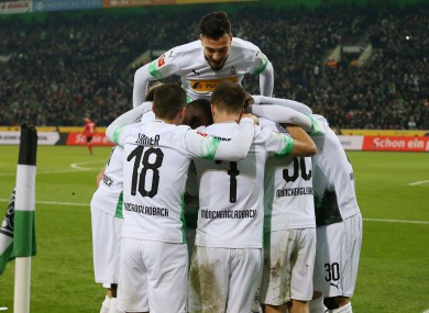 Borussia Monchengladbach players celebrate during their win.