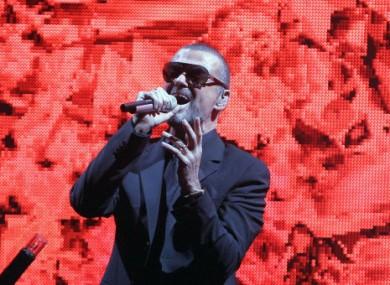 George Michael performs on stage in Paris in 2011.
