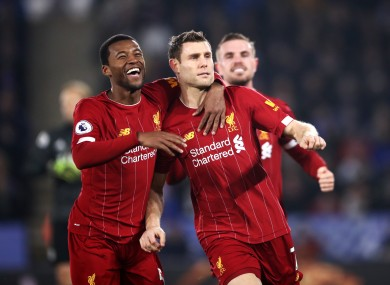 Liverpool's James Milner (right) celebrates scoring his side's second goal.