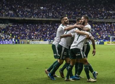 Palmeiras' players celebrate after scoring against Cruzeiro
