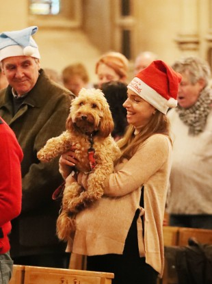 Caroline Price with her dog Penny during the annual Peata therapy dog carol service at Christ Church Cathedral in Dublin.