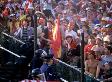 Liverpool fans pictured with the police inside Heysel Stadium.