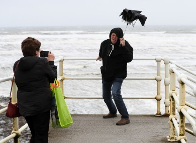 Tourists taking a photo during previous weather warnings in October.