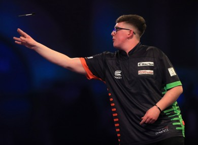 Keane Barry in his match with Vincent van der Voort during day four of the William Hill World Championships at Alexandra Palace, London.