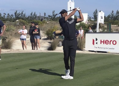 Tiger Woods tees off on the seventh.