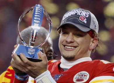 Patrick Mahomes with the Lamar Hunt Trophy after the Chiefs' AFC Championship win.