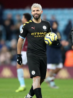 Sergio Aguero leaves the pitch with the match ball after Manchester City's win against Aston Villa.