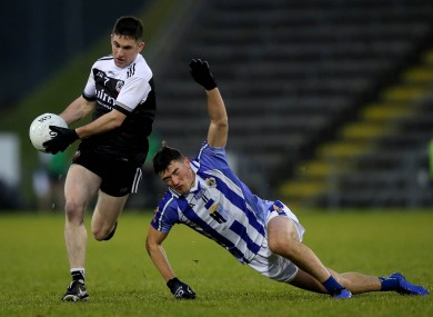 Kilcoo's Daryl Branagan goes past Colm Basquel of Ballyboden St. Enda's.
