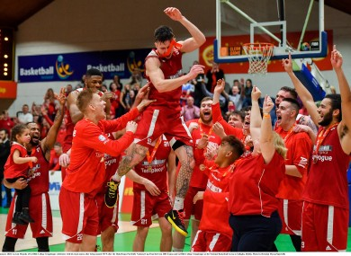 Lorcan Murphy of Griffith College Templeogue celebrates with his team-mates after being named MVP in the Hula Hoops Pat Duffy National Cup Final.