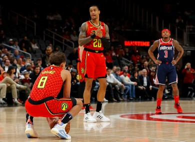 Atlanta Hawks guard Trae Young holds the ball
