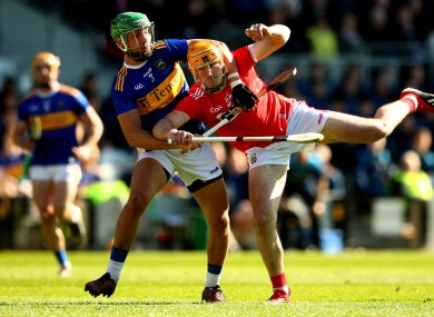 Tipperary's James Barry and Declan Dalton of Cork do battle last year.