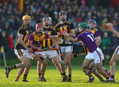 Kilkenny and Wexford players in action in today's semi-final.