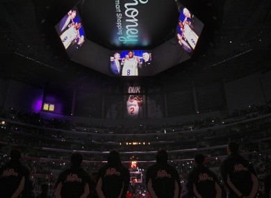 The Los Angeles Clippers stand for a video tribute to Kobe Bryant.