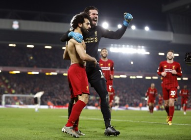 Salah and Alisson celebrate Liverpool's second goal.