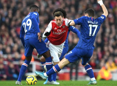 Mesut Ozil takes on Chelsea