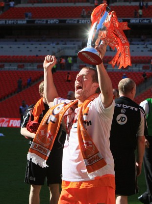 Billy Clarke celebrating after Blackpool's victory against Cardiff City in the 2010 Championship play-off final against Cardiff City at Wembley.