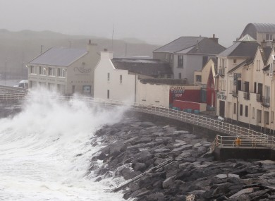 Waves crash agains the sea wall in Lahinch, County Clare.