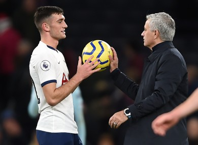 Troy Parrott is handed the match ball by Jose Mourinho at the end of his only senior appearance under the new manager.