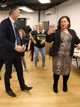 Sinn Fein leader Mary Lou McDonald and TD Chris Andrews doing the Macarena with children during an event in the Ringsend Irishtown Community Centre in Dublin.