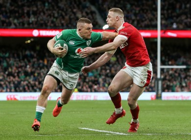 Conway gets beyond Johnny McNicholl to score Ireland's bonus point try.