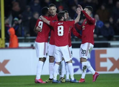 Man United players celebrate after Martial's goal.
