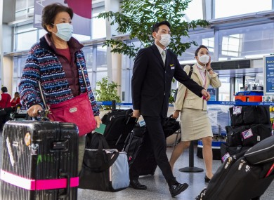 Korean travellers at an airport in San Francisco on Sunday.