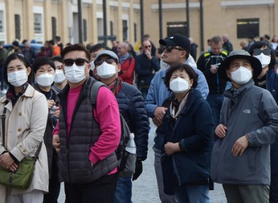 Tourists wear face masks at the Vatican in Rome.